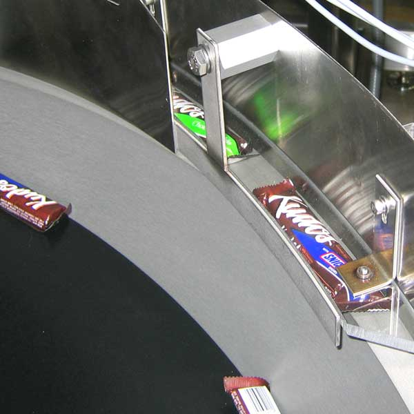 A collection of candy bars in a machine being processed.