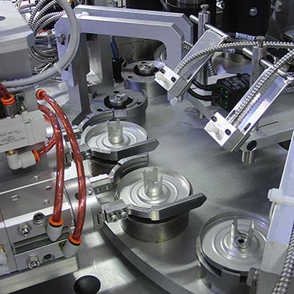 A five piece filter assembly line machine.