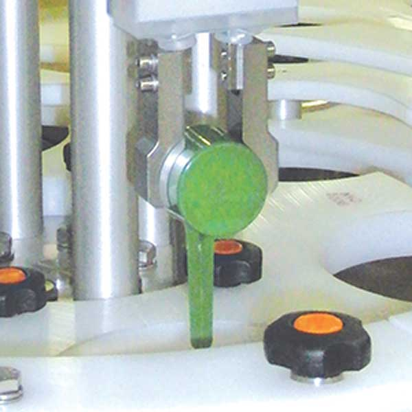 A scoop into canister machine in action.