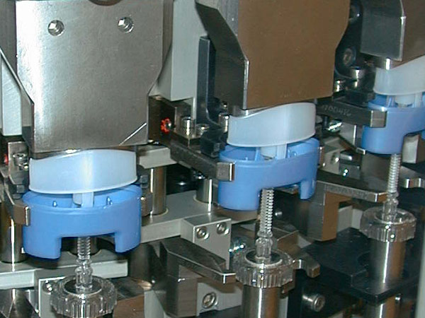 A group of deodorant sticks being assembled.