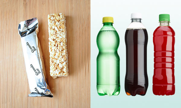 A stock photo of granola bars and drinks in bottles.
